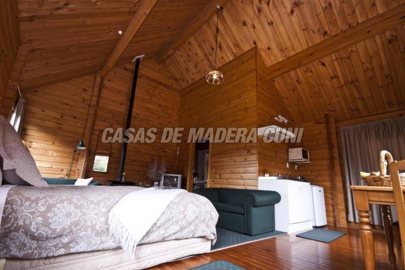 Casa de madera sam casas de madera y bungalows en - Interiores casas de madera ...